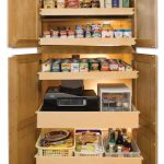 opened cabinets with pull-out panels for supplies storage