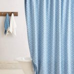 oval metal curtain rod in shower space with clip rings feature and beautiful blue shower curtain claw-foot tub in white permanent-wood hanger for towels and clothes