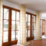 patterned-floor-to-ceiling curtains natural brown tiles floors wood planks ceiling in white color