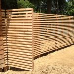 pool equipment room with vertical wood planks fencing