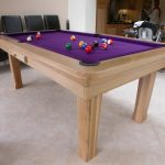 pool table for private billiard corner in bright purple surface with some biliard balls
