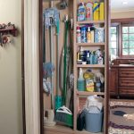 pull-out broom storage with shelving units for house-cleaning supplies