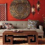 Red Wall Beautiful Moroccan Accent Wall Decor Lantern Shaped Lamp Gray Sofa Colorful Patterned Cushion Unique Wooden Coffee Table Beautiful Patterned Rug Stunning Moroccan Living Room