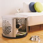 round metal-made crate for dog  with many holes feature chic round decorative pillows minimalist-style sofa a stainless steel dog-food-bowl wood-laminating floors