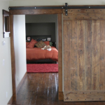 rustic barn sliding door for bedroom a kingbed furniture with red bed covering red  smooth fury carpet  wood-finishing floor