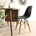simple study desk in wood material with drawers and elegant black chair