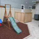 simple wood planks box for hiding pool equipment a mini playground in the back yard