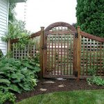 Small Creative Adorable Perfect Nice Lattice Fence Design With Small Wooden Made Design Concept For Bakyard Fence Design With Nice Green Garden