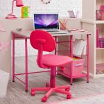 small  study desk in pink color with full pinky-chair a laptop unit a books arrangement a pink box as storage a cute pink table lamp  a large bookcase