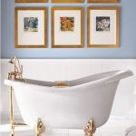 small white tub with gold-accent clawfoot and faucet white ceramic tiles floor idea arrangements of nature pictures in wood frames