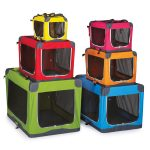 soft-material dog crates in various colors and sizes