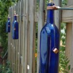 sophisticated and creative home-made blue bottle light fixtures for outdoor fence
