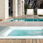 square large hot tub with white wide frame wood planks floor for outdoor a pair of white chairs for  pool luxurious outdoor pool furniture set for porch