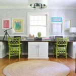 two person desk with storage bright green chairs in unique design mini round rug wood laminate flooring  two table lamps in different style some decorative painting for beautifying wall system