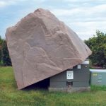 unique and creative wood equipment pad enclosure in natural stone look