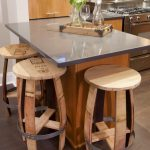 unique round barstools in wood material glossy tempered glass dining bar  two wine glasses and a decorative bottle