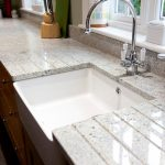 white cashmere granite countertop with square white porcelain sink  and stainless steel facet