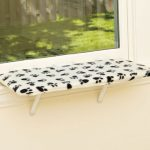 white dog window perch with black pet's footprints patterns