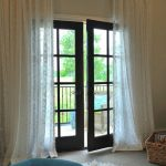 white lace curtains for French door with dark wood panel white fury carpet