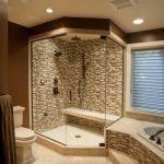 white subway tiles floor in frameless transparent glass panels shower a closet fixture beautiful mosaic tiled-shower wall