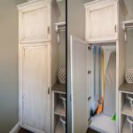 white-washed cabinet for organizing broom
