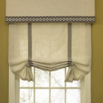 window Roman shade in cream with two vertical simple strips pattern