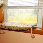 window perch for pets with pet's footprints patterna  white window shutters