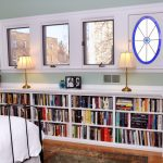 wonderful elegant large nice long under window bookcase with severla storage with white coloring choice and has many books