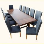 wood dining table with darker-finish leather-coat dining chairs in black