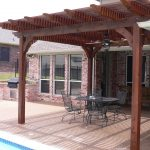 wood patio roof in darker wood finishing  black metal wire outdoor furniture for patio