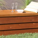 wooden box for pool filter storage that ends as outdoor table or bed