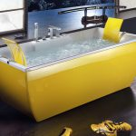 yellow tub with two opposite back and  double taps a pair of yellow sport shoes round table in wood black hardwood floor Japanese sliding door
