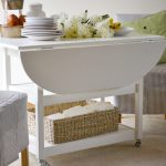 Nice-cool-modern-awesome-great-drop-leaf-dining-table-with-white-wooden-concept-larger-with-wheels-foot-for-dishes-place