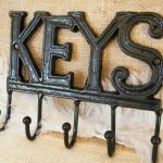 adorable-cool-nice-fantastic-stunning-black-iron-key-holder-for-wall-with-letters-design-that-uniquely-say-the-word-keys-black-design-metal-made-five-hooks-728x546