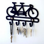 adorable-nice-classic-modern-Unique-Key-holder-ideas-for-Entrance-Door-Design-That-Will-Make-You-Excited-and-has-nice-bike-ornament-with-four-hooks-728x606