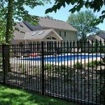 attractive-modern-cool-adorable-backyard-fencing-idea-with-black-iron-fence-concept-with-vertical-design-with-nice-green-environment
