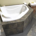 built-in minimalist and unique tub for two persons in white and faucet fixture black-washed tiles floors a rattan basket for storage  built-in concrete planter box for bathroom
