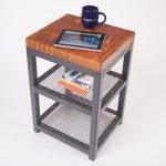 butcher block coffee table with under wire shelves high-tech computer tablet a black cup
