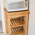 classic-tradtional-adorable-nice-simple-microwave-cart-with-original-wooden-made-with-three-leves-and-has-four-legs-without-wheels