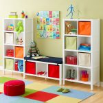 colorful carpet blocks for kids room twin white shelving units containing attractive boxes books animal dolls and private collections  a green slippers a red chair without back