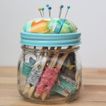 fantastic-nice-adorable-cool-sewing-kit-mason-jar-with-blue-turquoise-bed-cover-design-with-needles-on-the-top
