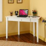 high-legs white corner desk with laptop a plant ornament a book a table-clock and pencil container  darkwood finish flooring dried-roots carpet as wood floor pad
