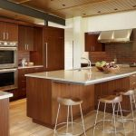 kitchen-soft-brown-wood-kitchen-islands-with-seating-wooden-and-chrome-legs-also-soft-granite-countertop-and-white-wall-color-also-soft-brown-wood-flooring-color-great-kitchen-island-728x547