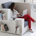 modern-nice-creative-cool-comfortable-library-reading-chair-from-studio-tilt-with-single-bookshelf-beside-and-border-concept