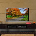 Nice Adorable Wall Mounted Tv Idea Samsung Led Tv With Black Frame Exposed Wall Brick Material Wooden Floor Material Cream Colored Area Rug Floating Tv Stand Unit With Multi Media 728x453