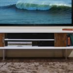 Nice Cool Simple Small Adorable Floating Media Console With Wooden Concept With Media Storage And Has Very Big Screen Tv 728x340