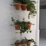 simple-cute-adorable-nice-wonderful-shelve-hanging-plants-with-three-levels-with-three-pots-each-level-with-rope-design