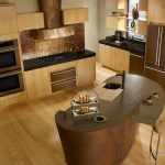 small and minimalist kitchen set with oil rubbed bronze kitchen appliances and solidwood floors a unique-shape kitchen island with single chair