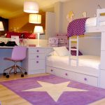 sweet light purple carpet with bigh white star in the center two bed furniture with ladder built-in study desk with movable purple chair warm and beautiful table lamp a wonderful pendant light fixture