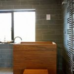 tiny-nice-coolest-traditional-bathroom-honey-brown-wood-color-deep-wonderful-japanese-soaking-tub-with-small-wood-chair-and-glass-window-also-grey-tile-wall-color-elegant-for-small-bathroom-728x1032